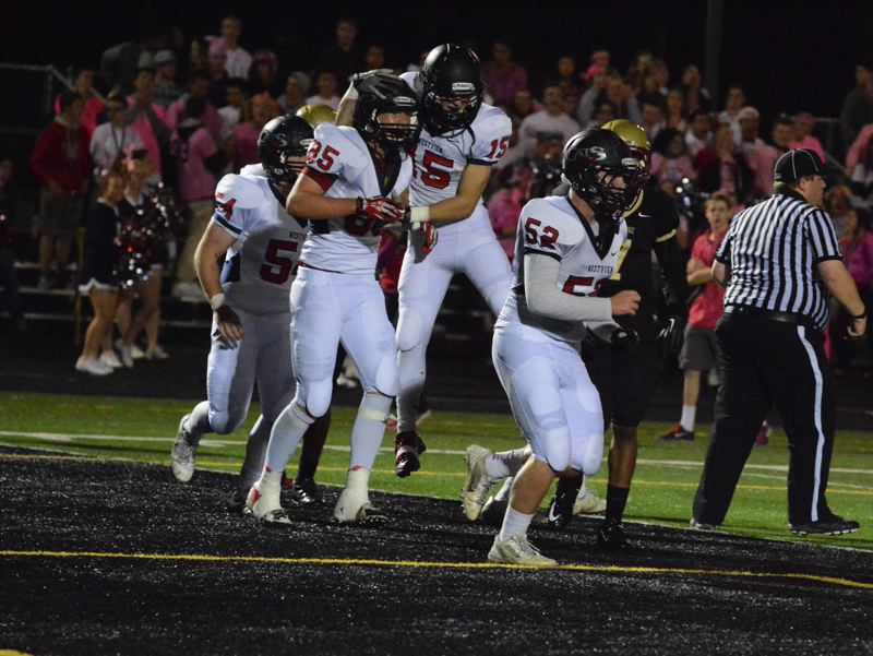 by: TIMES PHOTO: MATT SINGLEDECKER - Westview tight end Tegan Lind and running back Henry Sundin celebrate Linds game-tying touchdown in the first quarter of the Wildcats win over Southridge.