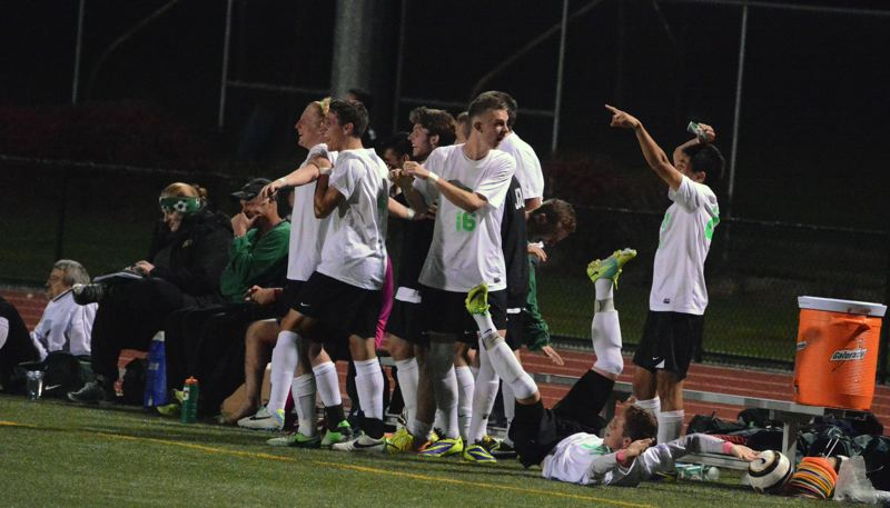 by: TIMES PHOTO: MATT SINGLEDECKER - The Jesuit boys soccer team celebrates senior Nic Porcellis goal in the second half of the Crusaders win over Aloha on Monday.