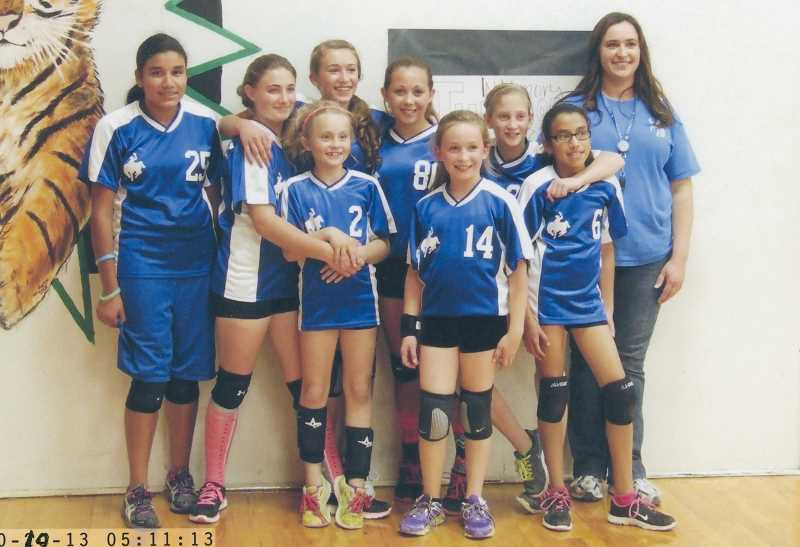 by: CONTRIBUTED PHOTO - Members of the Paulina volleyball team pose for a photo after taking second in Saturday's tournament at Dayville.