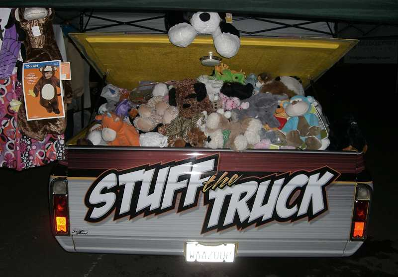 by: COURTESY OF LINDSAY WALKER - The annual Stuff the Truck event to collect costumes and stuffed toys for children suffering from cancer, injuries and other diseases is set for Oct. 25 during the Sherwood High School football game.