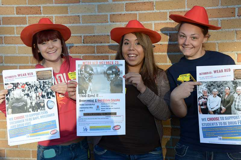 by: ALEX BITZ - SADD students left to right; Samantha Dunaway, Azucena Vargas and Megan Highsmith do their part to promote Red Ribbon Week.