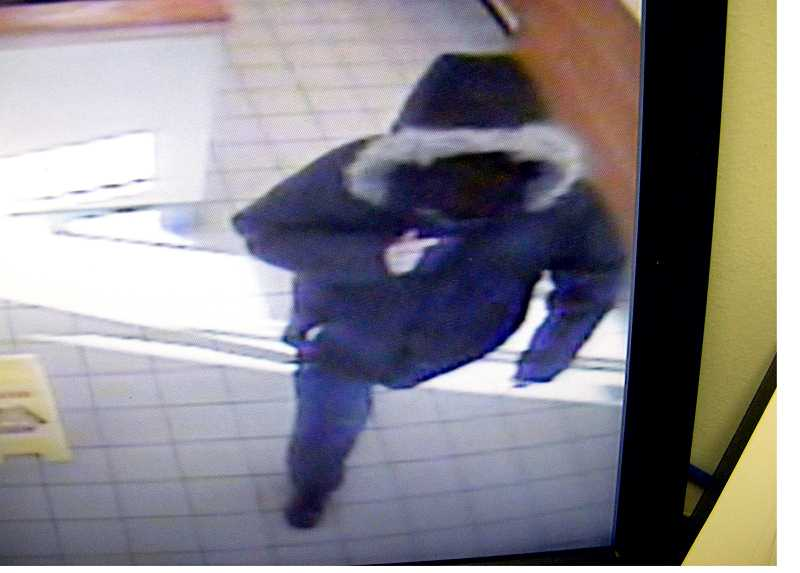 by: CONTRIBUTED BY MOLALLA POLICE DEPARTMENT - A view of the armed robbery suspect leaving the Molalla Subway Tuesday after pulling a knife on the restaurant manager and demanding cash from the register.
