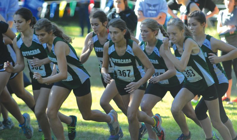 by: ESTACADA NEWS: DAVID BALL - The Estacada girls team comes off the starting line during last weeks district race at McIver Park. The Rangers finished second, beating LaSalle by 18 points for the last spot to state.