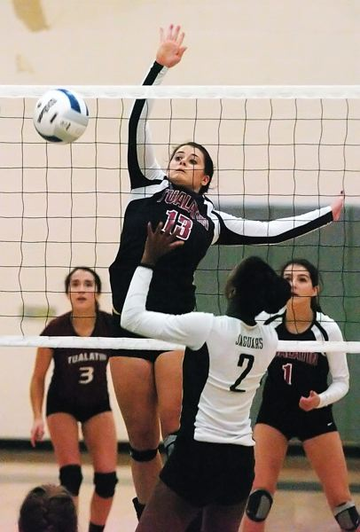 by: DAN BROOD - STANDING TALL -- Tualatin sophomore Haley Howarth puts the ball over the net during the match at Century.