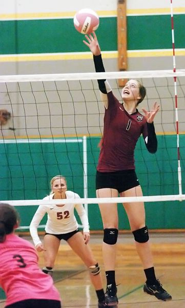 by: DAN BROOD - UP HIGH -- Sherwood freshman Sarah Penner, with teammate Maddisen McSmith behind her, goes above the net in Tuesday's match.