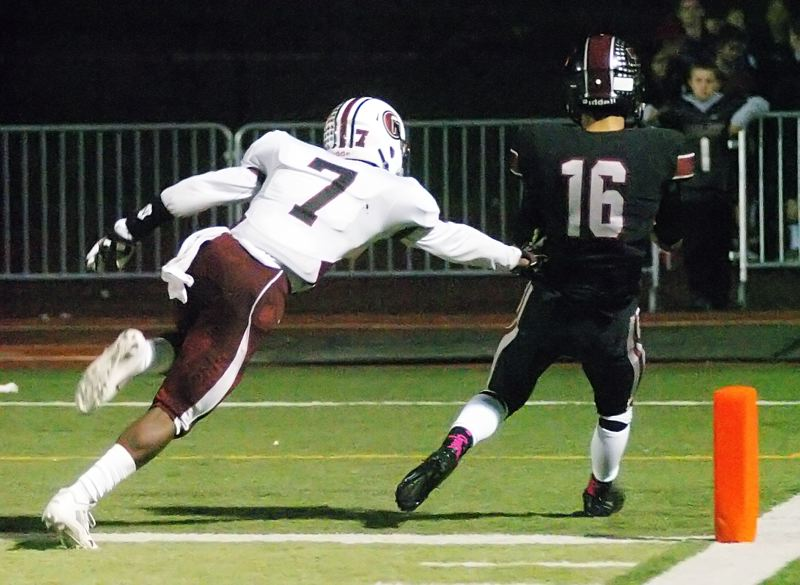 by: DAN BROOD - TUALATIN TD -- Tualatin senior receiver Nick Hines (16) catches a 34-yard touchdown pass in Friday's win over Glencoe.