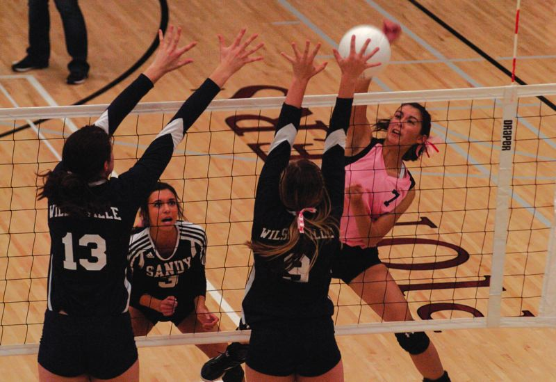 by: SANDY POST: PARKER LEE - Sandys Kayla Anderson goes above the net for a kill.