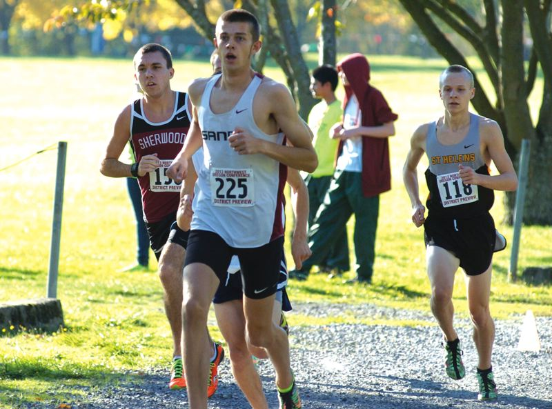by: SANDY POST: PARKER LEE - Sandys Isaac Mitchell leads a string of runners along a gravel trail at Blue Lake Park. He won the race in 16:27.6.