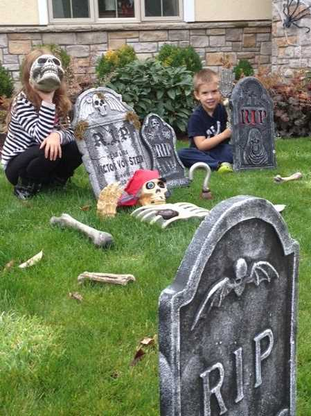 by: SUBMITTED - A graveyard, Pirate Pete and spooky kids can be found in 'Villeboo,' er Villebois. The Cases on Southwest San Remo Court transformed their yard into a graveyard this year.