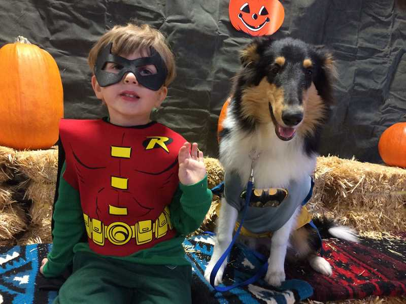 by: SUBMITTED - Nicholas Young, and his 6-month-old puppy, Kinzy, are dressing as dynamic duo Batman and Robin for Halloween.