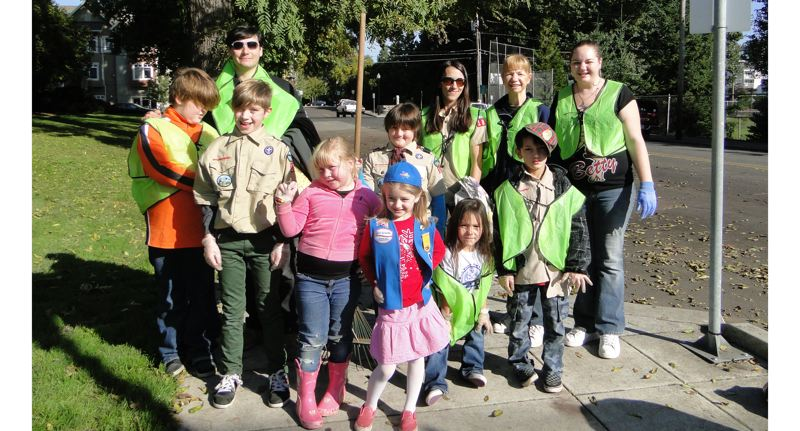 by: PHOTOS COURTESY: CITY OF MILWAUKIE - Cub Scouts celebrate their participation in a cleanup event in downtown Milwaukie earlier this month.