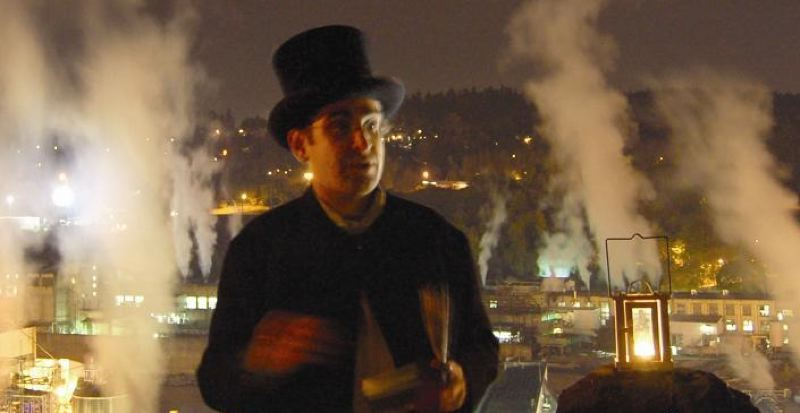 by: PHOTO COURTESY: WILLIAM BECKER  - Rocky Smith of Northwest Ghost Tours reads a scary story in front of the Blue Heron Paper Mill before it closed down in Oregon City.