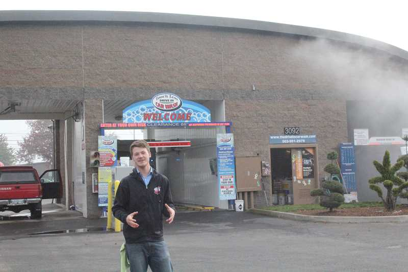 by: JEFF MCDONALD  - Jack Strom, manager of Touch Less Drive In Car Wash, shows off the two bays that offer high quality washes in Hubbard.