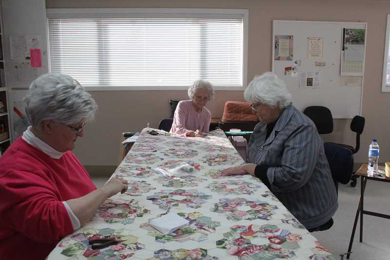by: LINDSAY KEEFER - (From left) Esther Connolly, Martha Telfer and Loreta Brubaker, pictured last year, are just some of the members of The Estates Quilters.