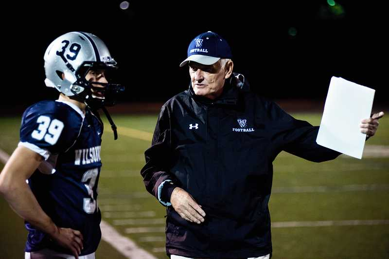 by: GREG ARTMAN - Greg Barton (right), a former NFL quarterback, is now an assistant football coach at Wilsonville High School. Above, Barton chats with Wildcats quarterback Elijah Benedick.