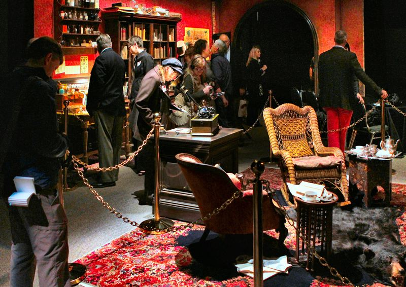 by: DAVID F. ASHTON - Guests explore the realistic depiction of Sherlock Holmes legendary study.