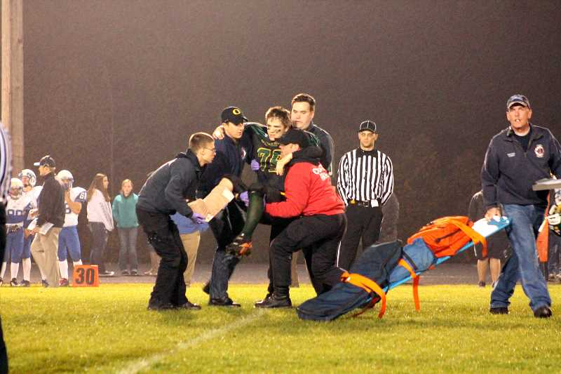 by: CORY MIMMS - Viking Brent Fine carried off the field after breaking his leg.