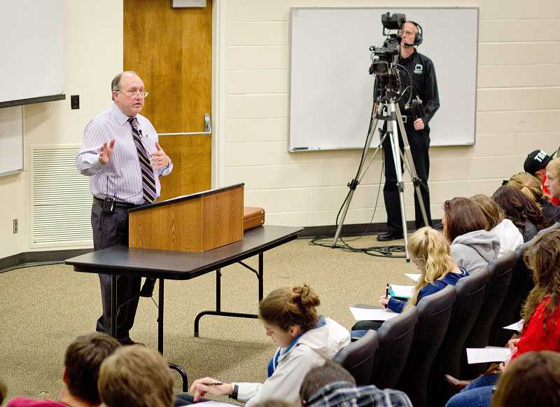 by: SUBMITTED PHOTO - 'Master lecturer' -- George Fox professor Kerry Irish regales his students with a lecture on American history as videographers from CSPAN record the event for an upcoming series on the network show.