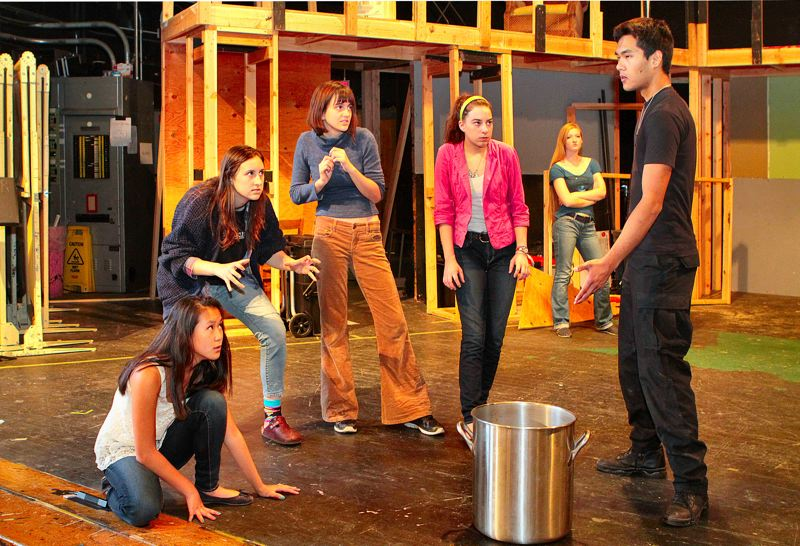by: DAVID F. ASHTON - Evan Billups (playing the Spirit) and Witches Anahelena Goodman-Flood, Anne Thornton, and Emma Hadley speak with Macbeth (Mykael Le) in the new Cleveland High production.