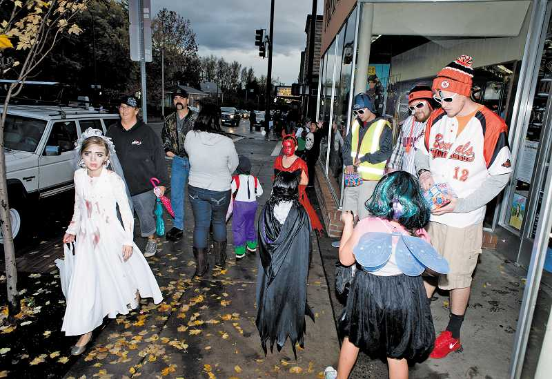 by: NEWS-TIMES PHOTO: CHASE ALLGOOD - Costumed children will once again trick-or-treat the merchants in downtown Forest Grove this year, as they have for many years past.