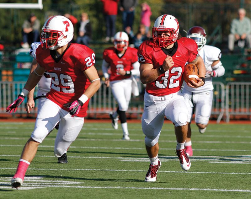 by: NEWS-TIMES PHOTO: AMANDA MILES - Pacific running back Bobby Ladiges (32) follows the block of teammate Jordan Fukumoto during Saturday's 21-6 nonconference victory against the University of Chicago.