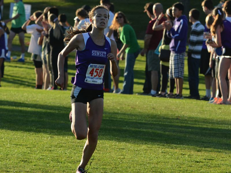 by: TIMES PHOTO: MATT SINGLEDECKER - Sunset sophomore Audrey Huelskamp ran a personal best 18:35 at the Metro League Championship to take third overall. The Apollo girls won the team title.