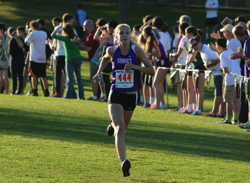 by: TIMES PHOTO: MATT SINGLEDECKER - Sunset sophomore Nicole Griffiths placed second at the Metro League Championship and helped the Apollos win the district team title.