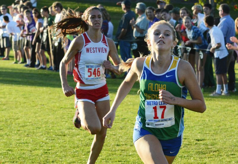 by: TIMES PHOTO: MATT SINGLEDECKER - Westviews Sarah Medved, back, was able to outkick Alohas Allison Martinez for fifth place overall at the Metro League Championship. Martinez still punched a ticket to the state meet with her sixth-place finish.