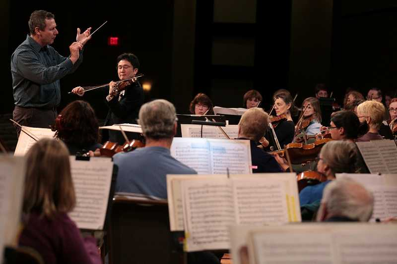 by: TIMES PHOTO: JONATHAN HOUSE - The Beaverton Symphony Orchestra rehearses with visiting Japanese violinist Kunito Nishitani.