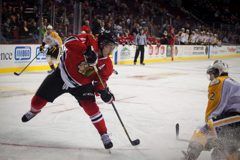 by: TRIBUNE PHOTO: ADAM WICKHAM - Defenseman Derrick Pouliot fires a shot in the Portland Winterhawks' ninth consecutive Western Hockey League victory.