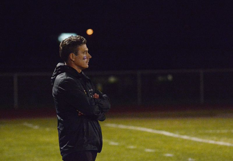 by: JOHN WILLIAM HOWARD - Head coach Simon Date watches over his team during the loss to Sherwood. Though the team failed to qualify for the playoffs this season, Date has said next years' team looks good.