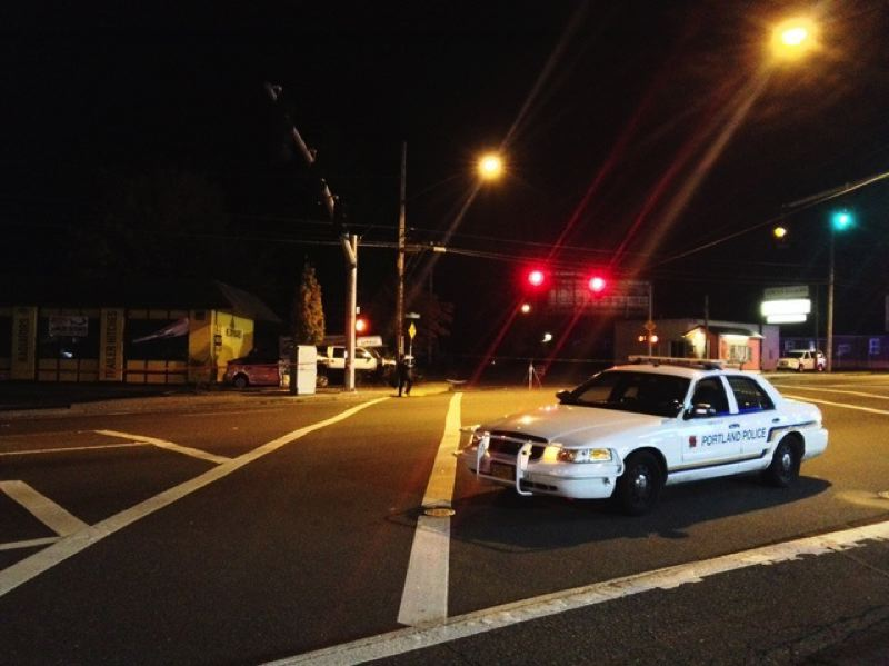 (Image is Clickable Link) by: PHOTO COURTESY OF KOIN 6 NEWS - A Portland Police Bureau squad car blocks the intersection of Southwest 30th Avenue and Southwest Barbur Boulevard following a single-vehicle fatal crash.
