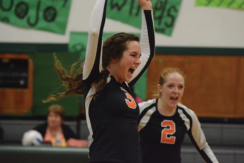 by: JOHN WILLIAM HOWARD - Tribe senior Abby Kessi lets loose to celebrate a point in the third set of the Indians' playoff loss at Estacada. The game was bittersweet for Kessi and her teammates, who had as good a game as they've played, according to head coach Mark Sprenger.