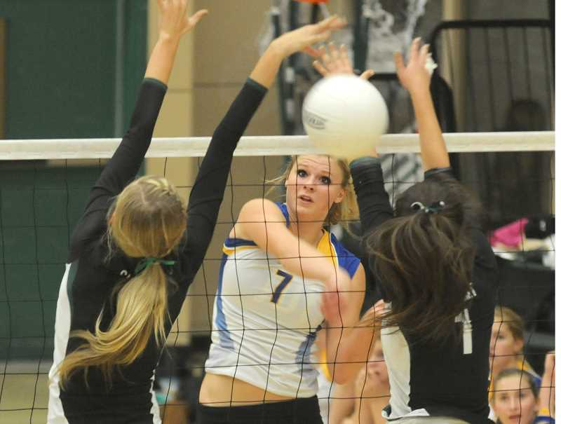 by: LON AUSTIN/CENTRAL OREGONIAN - Hannah Troutman goes up for a kill against Summit earlier this year. Troutman led the Cowgirls to a 9-1 record and first place in the Intermountain Hybrid League. Troutman was recently named player of the year for the league.