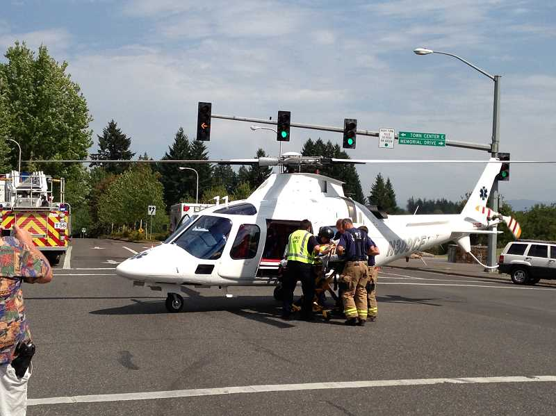 by: CLACKAMAS COUNTY SHERIFFS OFFICE - One of the teenage victims of the Aug. 7 accident is loaded into an air ambulance for transport to Oregon Health & Science University Hospital.