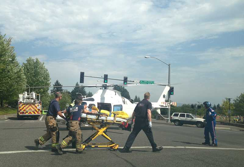 by: CLACKAMAS COUNTY SHERIFFS OFFICE - A 13-year-old victim recieves medical attention following an Aug. 7 accident on Wilsonville Road near Memorial Drive.