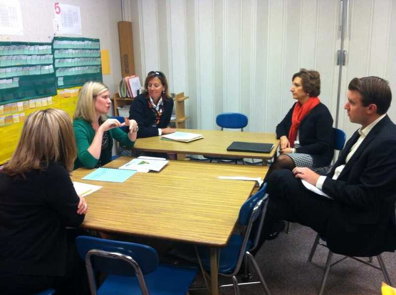 by: JAIME VALDEZ - Congresswoman Suzanne Bonamici, right, meets with staff at Durham Elementary School to discuss cuts to federal education funding, including Title I, which went into effect under sequestration.