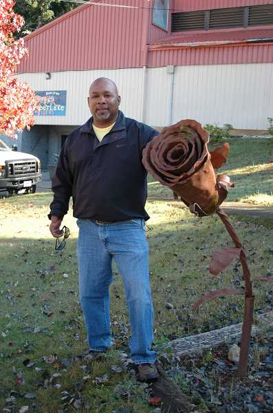 Photo Credit:  ISABEL GAUTSCHI - Timberlake Job Corps Community Liaison Warren Cunningham stands with a sculpture created by a former welding student.