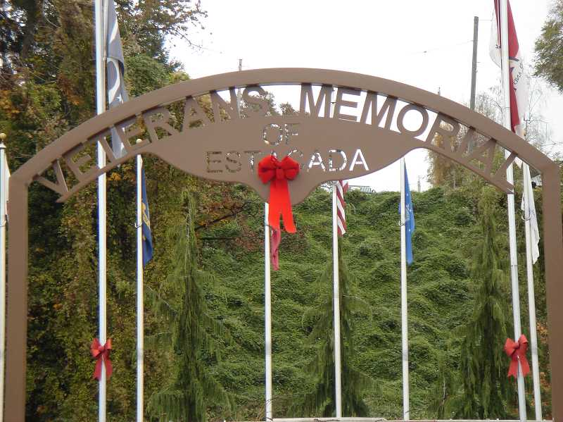 by:  SANDRA HUNT - The Estacada Area Support Our Troops Foundation was one of several organizations that participated in Red Ribbon Week. Red Ribbons were hung around the Estacada Veterans Memorial.