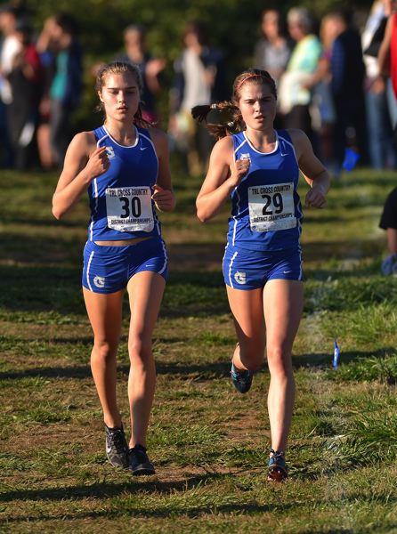 by: VERN UYETAKE/PAMPLIN MEDIA GROUP - Grant's girls claimed the Three Rivers League district meet handily behind top runners Piper and Ella Donaghu.