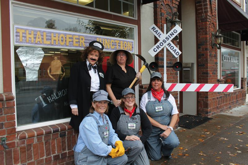by: OUTLOOK PHOTO: CARI HACHMANN - Ladies at Troutdale City Hall in downtown dress up for Halloween.