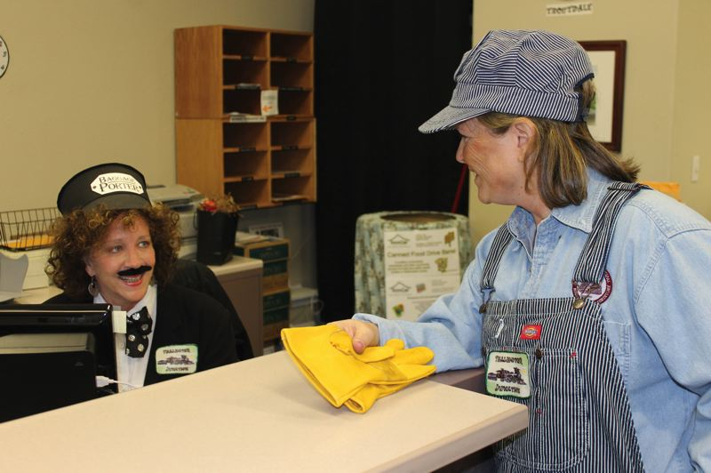by: OUTLOOK PHOTO: CARI HACHMANN - City Recorder Debbie Stickney, right, and Kelley Graham, receptionist, raise office morale in costume.