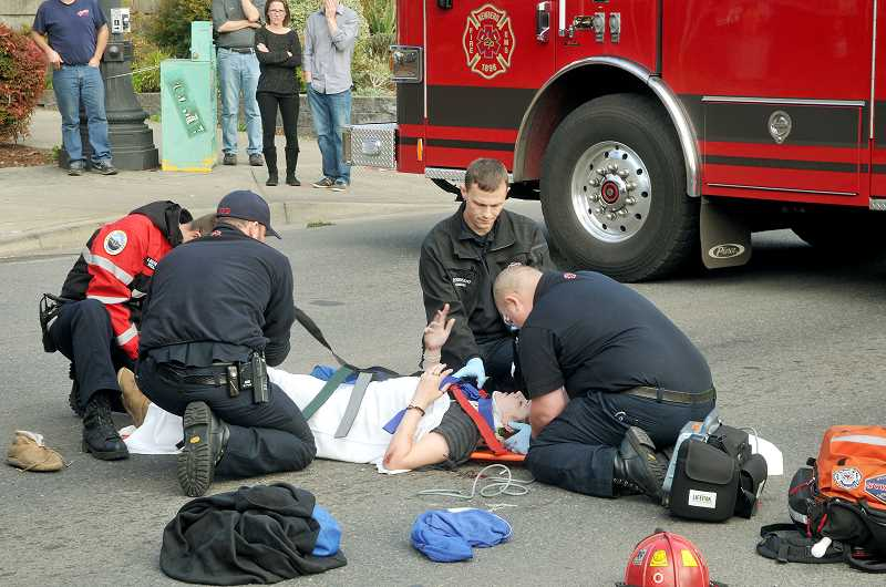 by: GARY ALLEN - The victim of a collission between a dump truck and a bicycle was transported by EMTs to Providence Newberg Medical Center Friday afternoon. She was conscious and cognizant at the time of the transport.