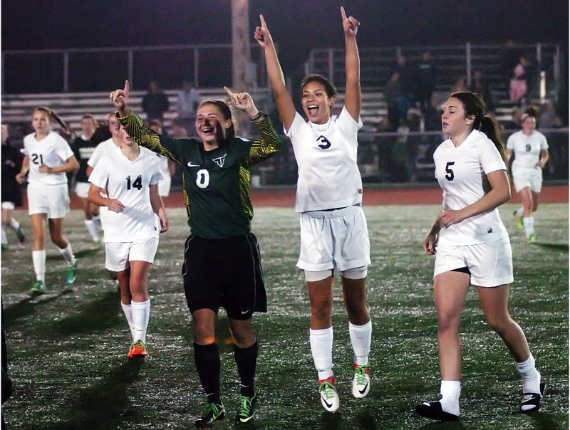 by: DAN BROOD - VICTORY MARCH -- The Tigard High School girls soccer team, including sophomore Larysa Cleaver (0) and junior Madison Bickel (3) celebrate following the Tigers' conference title-clinching win over Forest Grove.