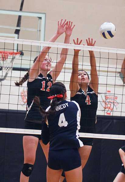by: BILLY GATES/THE PIONEER - Culver's Hannah Lewis (left) and Andrea Retano (right) attempt to block the attack of Kennedy's Lakin Susee during Saturdays Tri-River Conference tournament championship match.