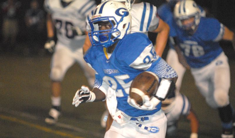 by: THE OUTLOOK: DAVID BALL - Greshams Gregonta Brown breaks into the open during the first half of Fridays 48-15 win over Hillsboro.
