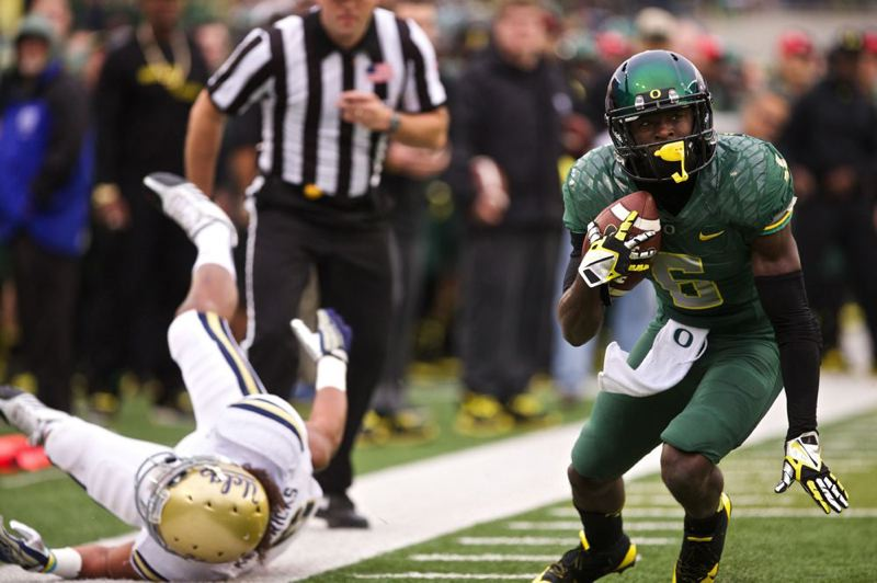 De'Anthony Thomas lunges fot the end zone, leaving a Bruin in his wake.