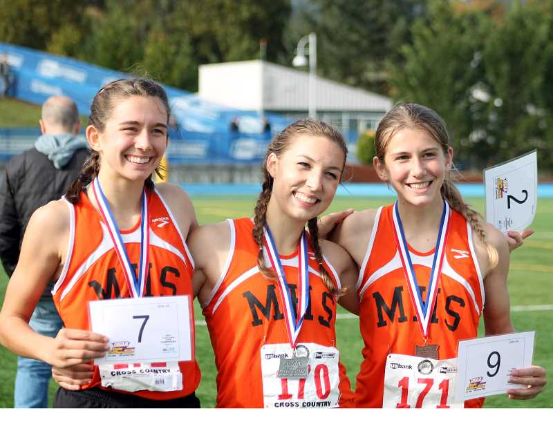 by: CORY MIMMS - Finishing among the top ten, from left to right, Hannah Clarizio, Emily Bever and Amanda Clarizio.