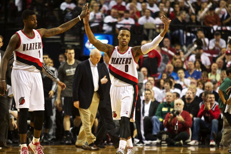 by: TRIBUNE PHOTO: JAIME VALDEZ - Damian Lillard (right) gets a high five from Trail Blazers teammate Dorell Wright after hitting a shot at the end of the third quarter Saturday night at Moda Center.