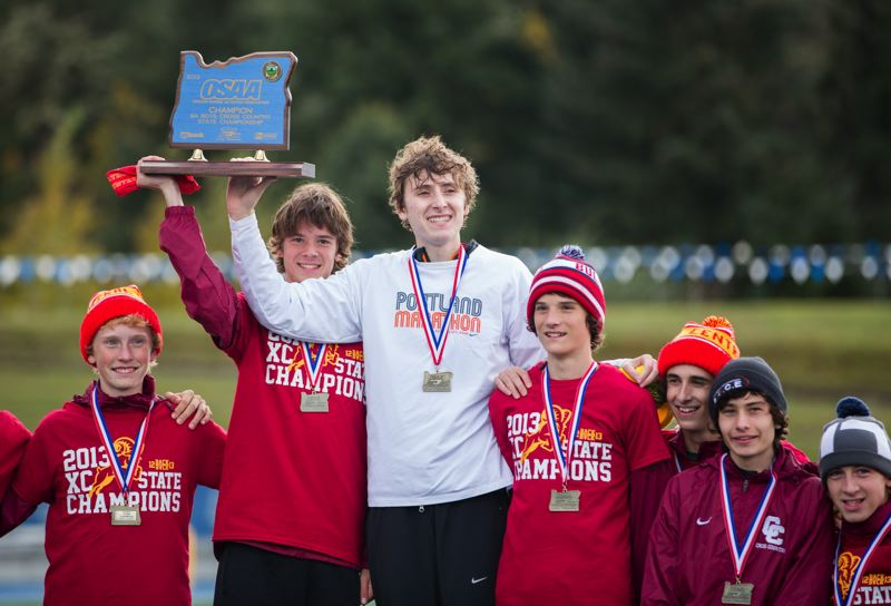 by: COURTESY OF DAVID BLAIR - Central Catholic's boys celebrate their team victory in the Class 6A cross-country meet at Eugene's Lane Community College on Saturday.